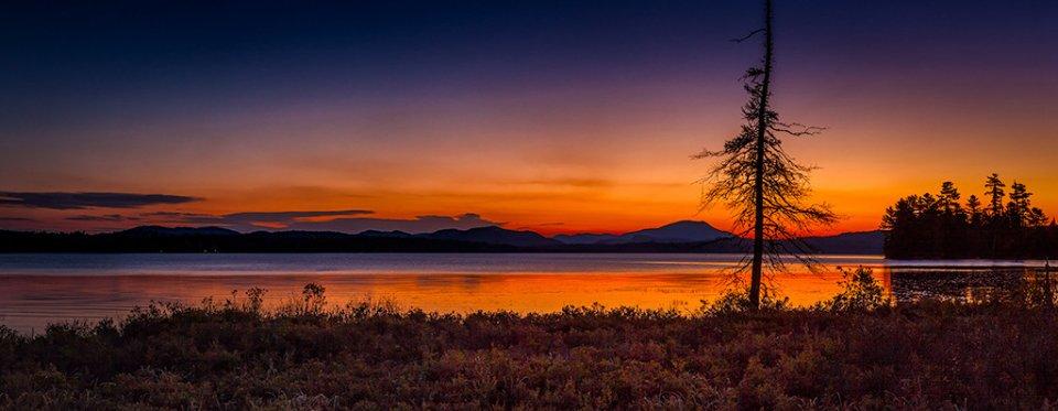 2013-04_PRINT_Rick-Tyrseck-Dawn-at-Raquette-Lake-1024x398