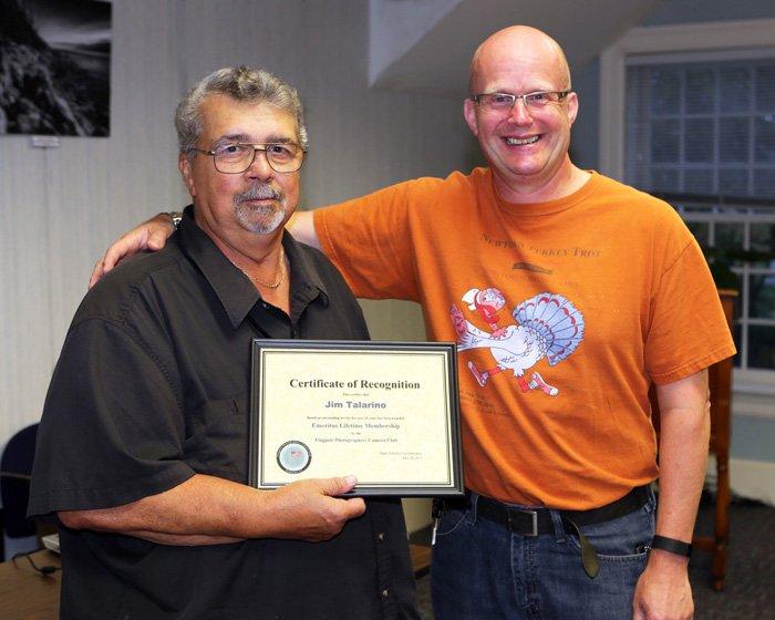 Jim Talarino getting award